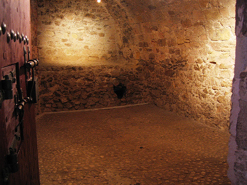 A photograph of the inside of the Dantes cell in the real life Château d'If, which is named after the titular character.